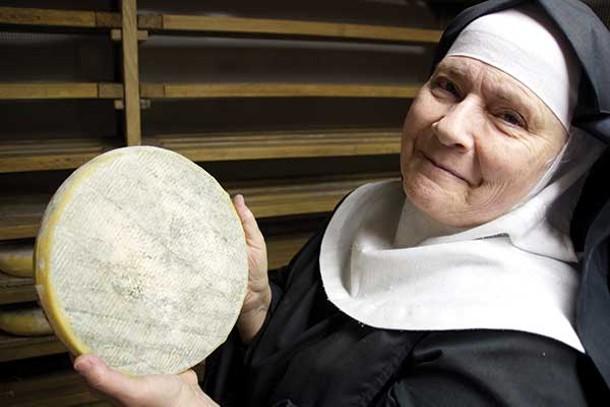 Mother Noella Marcellino in the aging room, holding a wheel of Bethlehem. - PETER BARRETT