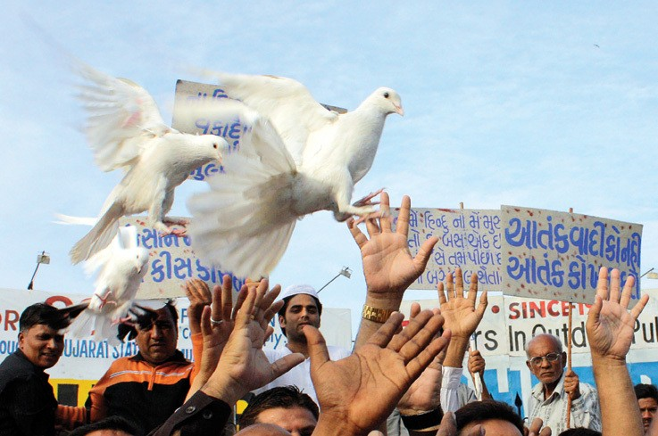 Muslims release pigeons symbolising peace during a rally in the Indian city of Ahmedabad following the Mumbai attacks November 29, 2008.