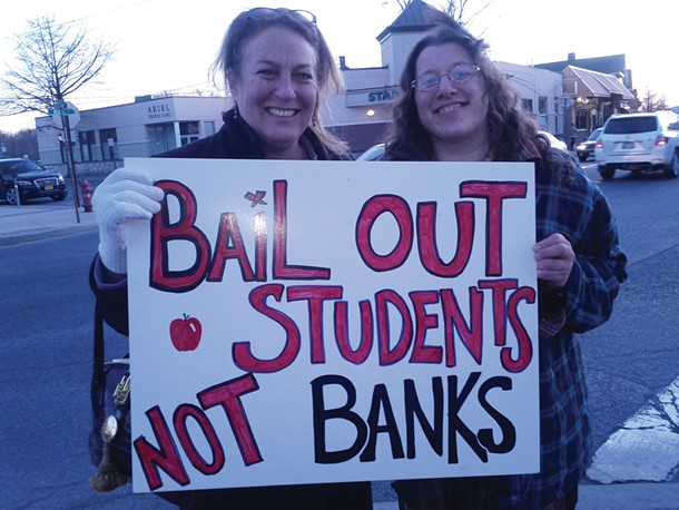 New Paltz Town Supervisor Susan Zimet and Amanda Sissenstein of Occupy New Paltz at the #Occupy Education March and Rally in downtown New Paltz on March 10. Photo: Michelle Ridell.