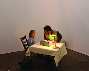 """Ori Alon helping Zora write a letter to her parents. He performs """"Letters of all Sorts"""" in Beacon this month."""
