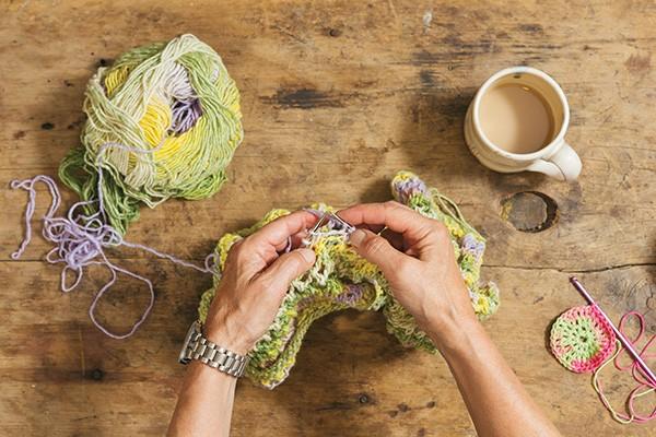 Paula Kucera knitting at White Barn Farm in New Paltz