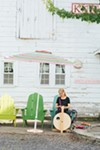 Paula Kucera spinning yarn at White Barn Farm in New Paltz