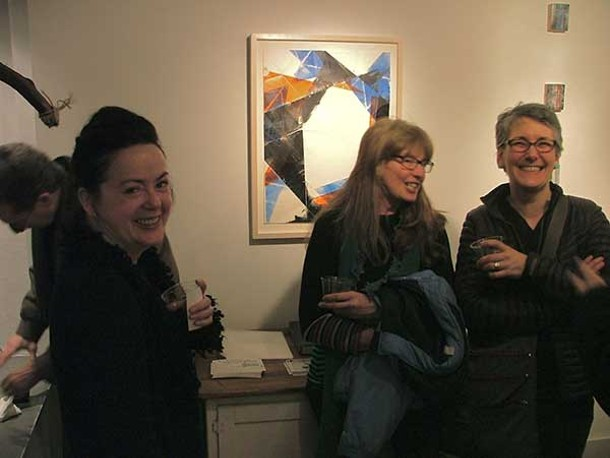 """People gather around the work of Ken Gray at the """"Bent"""" exhibition opening at Imogen Holloway Gallery during Saugerties First Friday."""