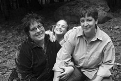 Peri Rainbow-Sloan, Cecilia Rainbow-Sloan, and Tamela Rainbow-Sloan outside their home in October, 1994.