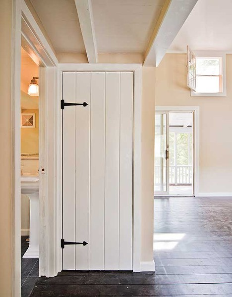 Period replica iron strap hinges were chosen to mimic the original style of the house.