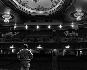 Peter Hughes, advertising manager of Proctor's, surveys the renovated theater.