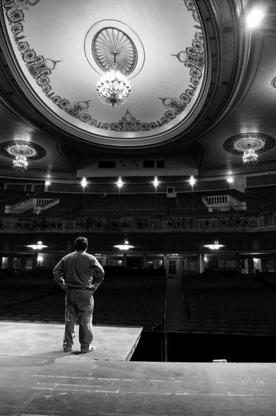 Peter Hughes, advertising manager of Proctor's, surveys the renovated theater. - HILLARY HARVEY