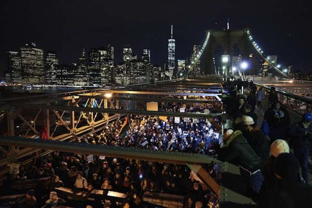 Protesters block the Brooklyn Bridge Dec. 3 following the grand jury decision in the choking death of Eric Garner. - JAMES KEIVOM / NEW YORK DAILY NEWS