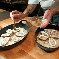 Fish & Game Putting the finishing touches on Fish & Game's fire river oysters. Roy Gumpel