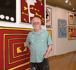 Rick Rogers at X on Main in Beacon, hanging art by Ryan Cronin - ROB PENNER