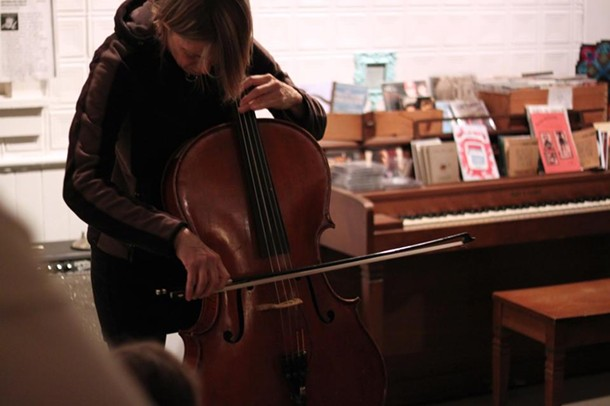 "Rock-cellist Helen Money plays the ""9 and 13"" opening reception at Team Love RavenHouse Gallery in New Paltz."
