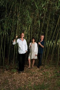 Sam Truitt, Susan Quasha, and George Quasha outside of the Quasha's home in Barrytown.