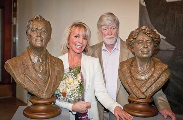 Sculptor Carolyn Palmer and David Roosevelt pose next to Palmer's new sculptures of Franklin and Eleanor at the FDR Presidential Library and Museum. - ERIC ANTHONY JOHNSON