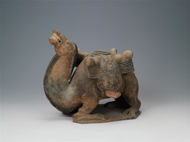 Sitting Camel, Northern Qi dynasty (550-577 CE), tomb dated 570 CE, painted earthenware, 24.7 × 29.7 cm, unearthed 1979, tomb of Lou Rui (d. 570 CE), Wangguo Village, Taiyuan, Shanxi Province, Shanxi Museum, Taiyuan.