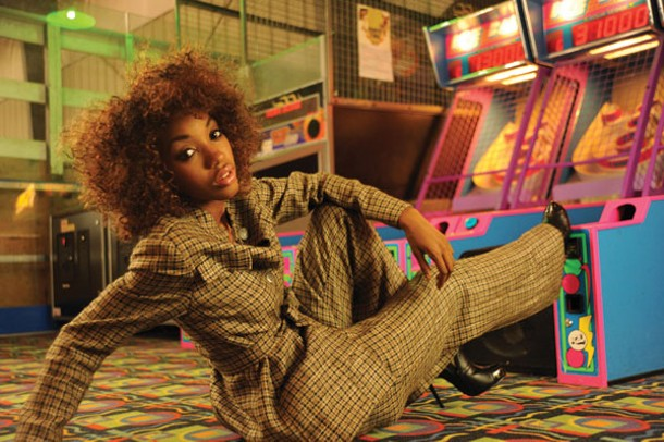 Skee Ball Business: Saadah Garbey wearing Franka, London 1970s mod pantsuit. Makeup by Saadah Garbey. From Joanne Klein Vintage. - KELLY MERCHANT