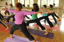 Students participate in a yoga class in Kripalu's award-winning green-built Annex that opened last summer.