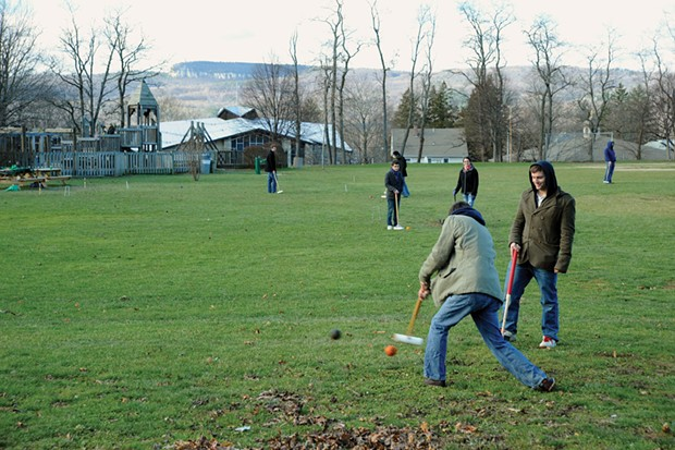 Students playing croquet in Hasbrouck Park, across from the SUNY New Paltz campus, with the Shawangunk Ridge in the background.