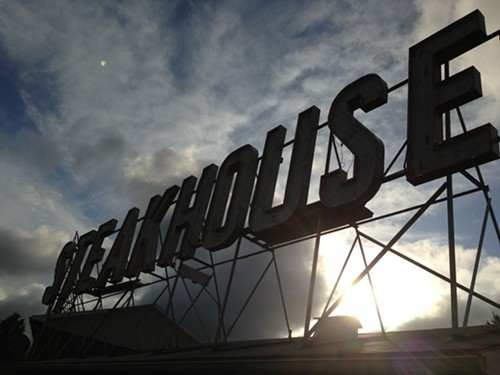 Sun sets behind the iconic Skytop Steakhouse sign