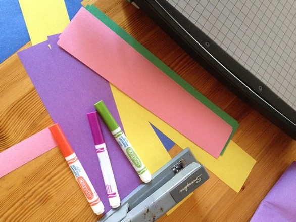 Supplies to make a resolution chain (cutting board, construction paper, markers, stapler) - HILLARY HARVEY