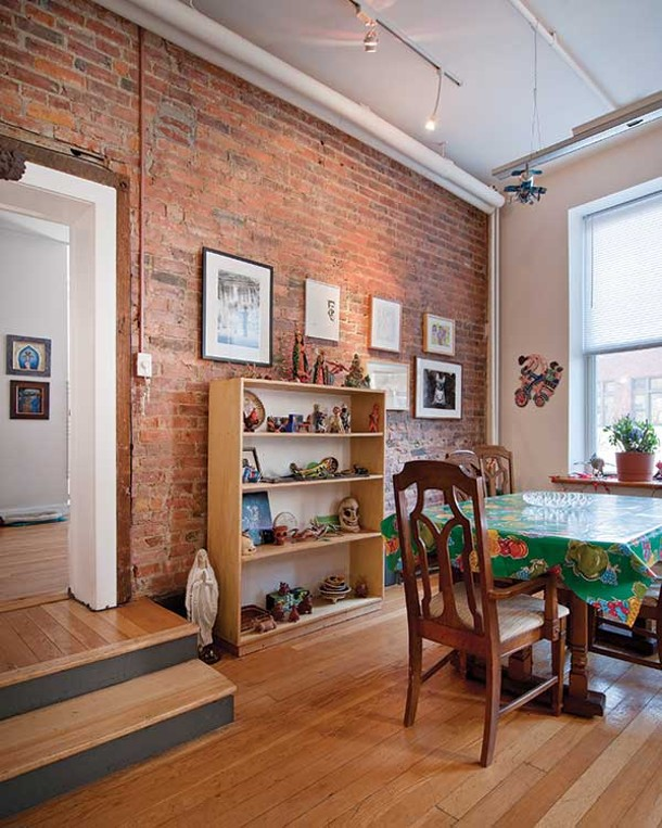 The dining area includes photos by internationally exhibited artists Billy Name and Robin Schwartz. The bookshelf is stacked with Mexican folk art. - DEBORAH DEGRAFFENREID