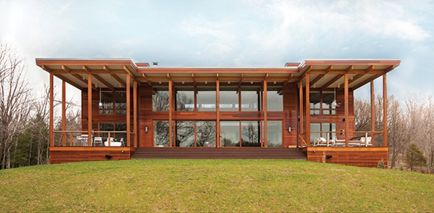 The dramatic large overhangs on the south wall facing the pond shield the home from unwanted summer solar gain, while the walls of glass provide passive solar heating in winter. Lindal's signature Western Red Cedar siding complements the desi
