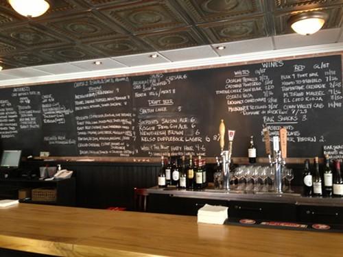 The elegant wine bar and chalkboard menu at Bread & Bottle