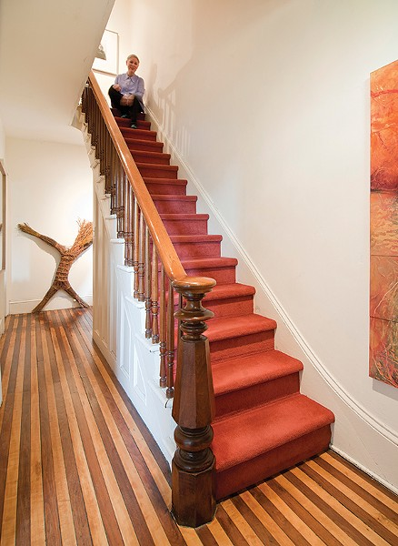 The entry floor is original, with boards of maple and black walnut.