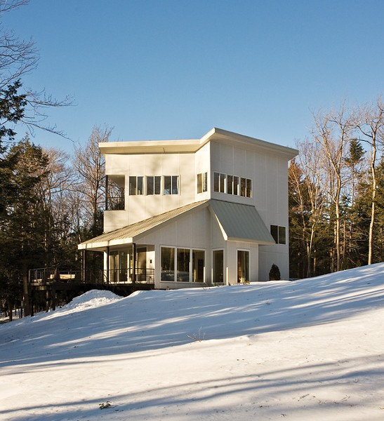The main facade of the house faces full sun and the forest instead of the driveway. The siding from Hardie Panel is energy efficient and low maintenance. - DEBORAH DEGRAFFENREID