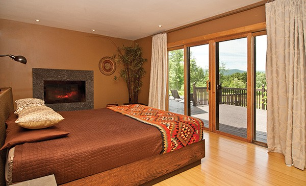 The master bedroom, with fireplace and patio - DEBORAH DEGRAFFENREID