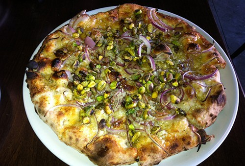 The Morandi (Grana Padano, red onions, pistachios, and rosemary) pie at Posto Pizzeria