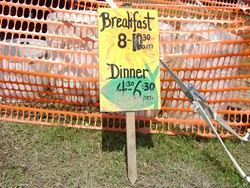 The sign at the volunteers' food tent. - RACHEL CAREY