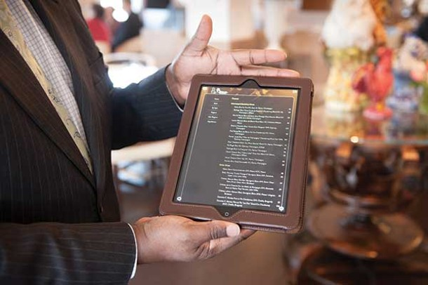The wine list is presented to diners on an iPad. - JENNIFER MAY
