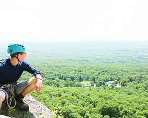 Thomas Smith takes in the view from the West Trapps in the Mohonk Preserve.