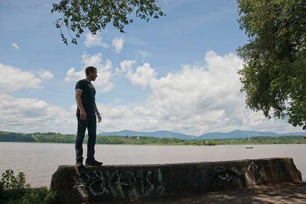 Tivoli Deputy Mayor/painter Joel Griffith looking toward the Catskills on the bank of the Hudson River. - ROY GUMPEL