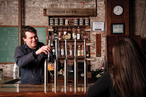 Tom Keegan behind the bar at Keegan Ales in Kingston. - JENNIFER MAY