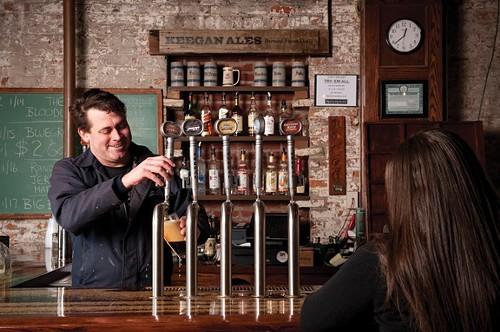 Tom Keegan behind the bar at Keegan Ales in Kingston.