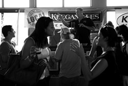 Tommy Keegan of Keegan Ales manning his taps at the New York State Beer Expo at Terrapin Catering on July 17. - JENNIFER MAY