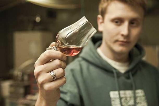 Tuthilltown Spirits packaging manager Brendan O'Rourke taste testing Hudson Whiskey.