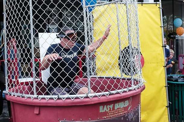 The editor being dunked in 2013. He is still suffering from dunk tank PTSD. He will not be in the tank at this year's block party on August 15. - TOM SMITH