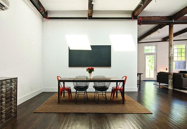 Custom dining room table by Thomas Filiaggi of Loft 3F. - Scored slate artwork by Stephen Spaccarelli. - DEBORAH DEGRAFFENREID