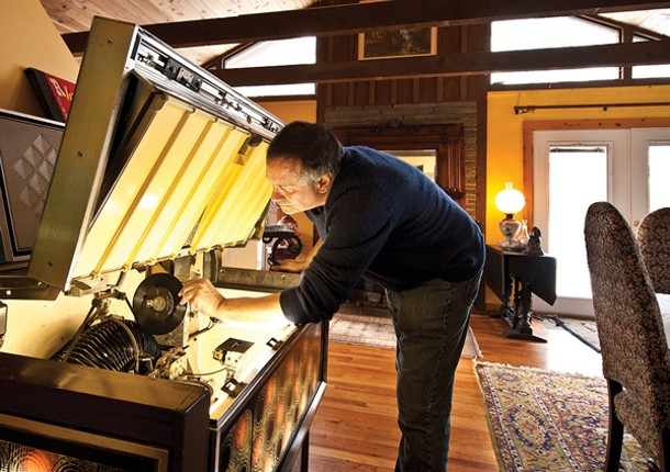 Basile programs his Rowe AMI R-80 jukebox. - DEBORAH DEGRAFFENREID
