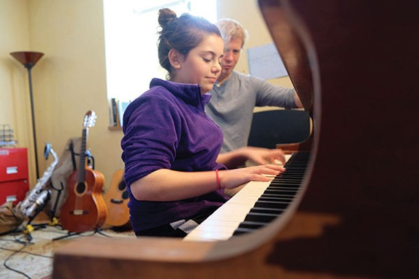 Ben Senterfit giving a piano lesson to Talia Lipke at the Community Music Space in Red Hook - ROY GUMPEL
