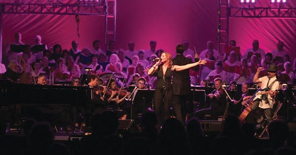 """Emily Drennan and Ralph Legnini performing in """"Americana"""" with 100 choristers, an orchestra, and David Wroe conducting at the 2015 Phoenicia International Festival of the Voice"""