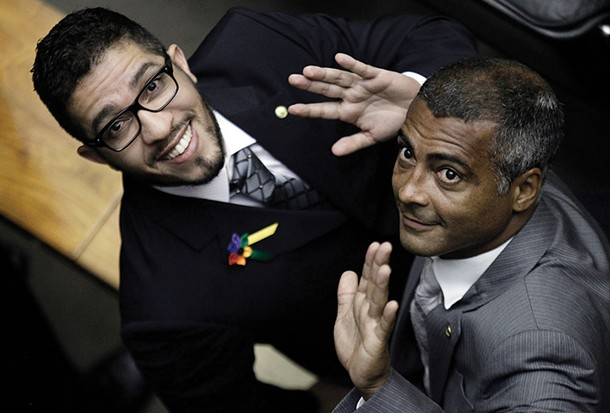 Brazilian Rep. former soccer player Romario (R) and Congressman Jean Wyllys wave during the inauguration ceremony in Brasilia in 2011. - REUTERS/UESLEI MARCELINO