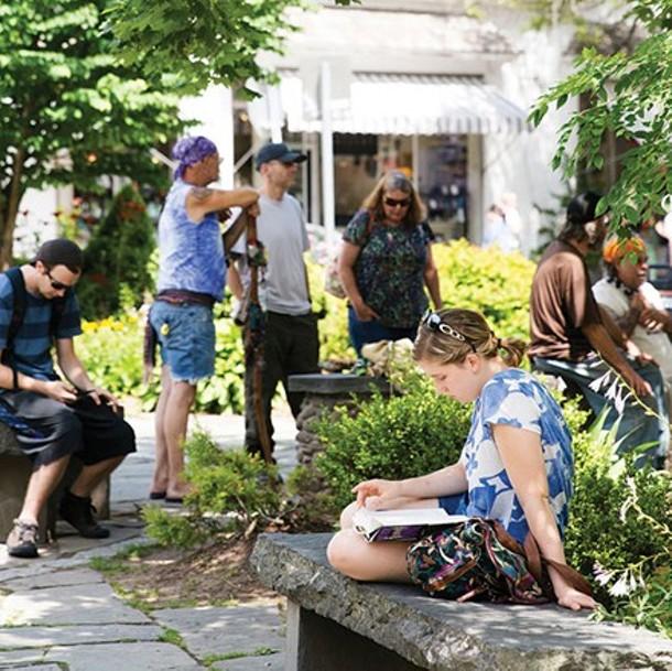 People on the Village Green in Woodtsock - EVA DEITCH