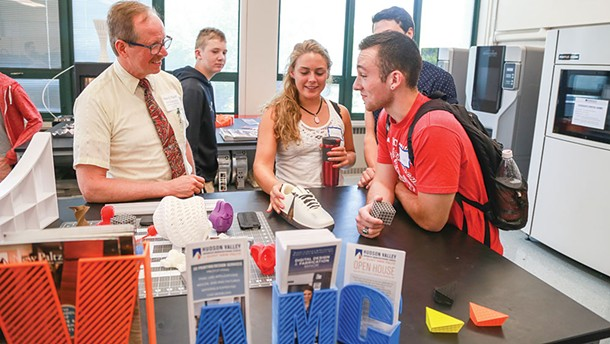 Students and leaders discuss 3D printing at the Hudson Valley Advance Manufacturing Center's Open House at SUNY New Paltz