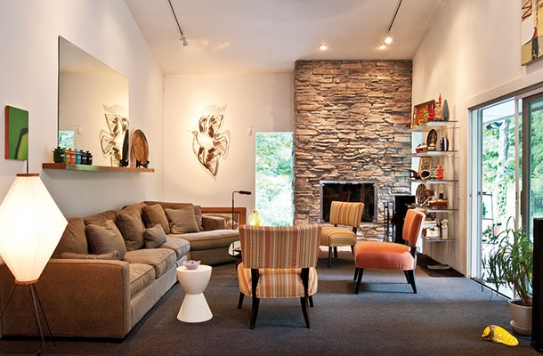 """The large, airy living room has ample seating for guests. Along with inviting friends over for dinner Aronson loves to host game nights. """"Cards Against Humanity"""" has become a favorite. - DEBORAH DEGRAFFENRIED"""