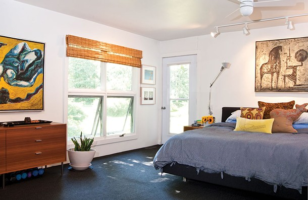 Aronson's south facing master bedroom is tucked away in a private corner of the house. - DEBORAH DEGRAFFENRIED