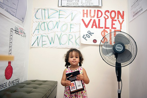 Callie Jayne's younger daughter Althea in the kids' area at the Citizen's Action office in Kingston. - HILLARY HARVEY