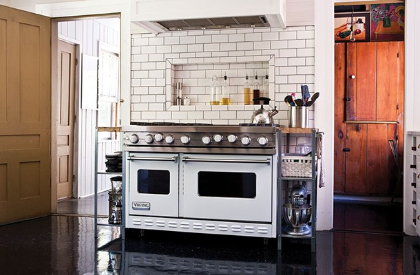 The home's renovated main kitchen. O'Connell did much of the home's tile work. - DEBORAH DEGRAFFENREID